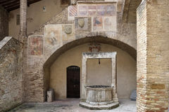 Frescos and well Tuscany Stock Images