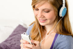 Fresh adolescent girl listening to music. With mp3 player stock images