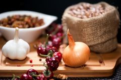 Fresh agriculture vegetables as onions, garlic and bean seeds Royalty Free Stock Photography