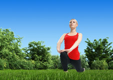 Fresh air fitness - Blonde on lea Royalty Free Stock Photos