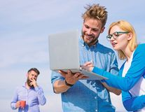 Fresh air helps to refresh mind. Colleagues laptop work outdoor sunny day, sky background. Deadline concept. Friends. Enjoy fresh air and keep working royalty free stock photography