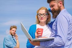 Fresh air helps to refresh mind. Colleagues laptop work outdoor sunny day, sky background. Outdoor workspace concept. Colleagues with laptop discussing plan stock image