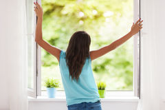 Fresh air. Young woman breathing fresh air during the summer Royalty Free Stock Images