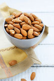 Fresh almonds in a ceramic bowl Royalty Free Stock Photography
