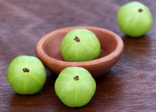 Fresh amla with a small bowl Royalty Free Stock Image