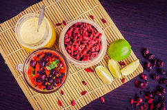 Fresh antioxidant herbal tea from goji berries. Fresh antioxidant herbal tea from dried goji berries, sweetbrier and blueberry in a glass cup on wooden Stock Photo
