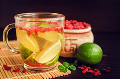 Fresh antioxidant herbal tea from goji berries. And lime in glass cup. Wolfberry for a healthy diet. Healthy food. Alternative medicine. Recovery. Rejuvenation Royalty Free Stock Photo