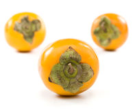 Fresh appetizing persimmon Royalty Free Stock Photos