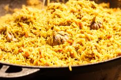 Fresh appetizing pilaf. Cooked with fried lamb, rice, garlic, ca. Rrots in a large caviar Royalty Free Stock Image