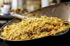 Fresh appetizing pilaf. Cooked with fried lamb, rice, garlic, ca. Rrots in a large caviar Stock Photos
