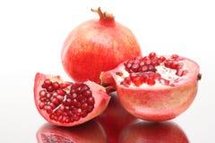 Fresh appetizing pomegranates Stock Images