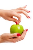 Fresh apple. Female hands holding an apple on white background Stock Photography