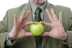 Fresh apple. Fresh green apple in businessman hands stock photography