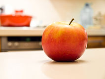 Fresh apple. On the kitchen desk Stock Photos