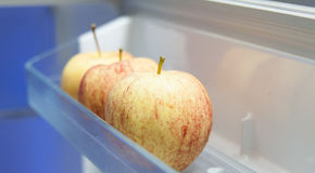 Fresh Apple. S in the refrigerator Stock Photography