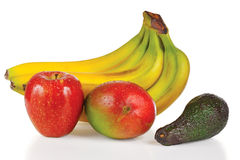 Fresh apple, avocado, mango and bunch of bananas Stock Photos
