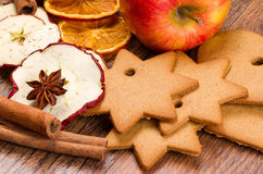 Fresh apple with biscuit,cinnamon and fruit dried. On wooden table Stock Photos