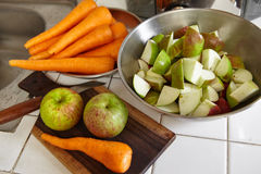 Fresh apple and carrot. Being prepared to be juiced Royalty Free Stock Images
