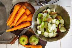 Fresh apple and carrot. Being prepared to be juiced Stock Image