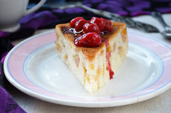 Fresh apple charlotte cake with cherries in plate Stock Photography