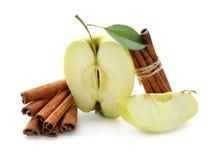 Fresh apple and cinnamon sticks on white background royalty free stock photo