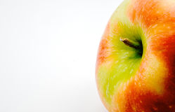Fresh apple close up on white background. Selective focus. Royalty Free Stock Image