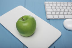 Fresh apple. Concept in style: Investing in computer technology. Horizontal Stock Image