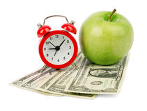 Fresh apple with dollars and alarm clock Stock Photo