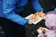 Fresh apple fritters sprinkled with cinnamon sugar. Favourite children snack on Christmas market in Switzerland. stock photos