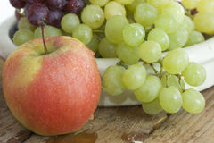 Fresh apple and grapes close-up Royalty Free Stock Photography