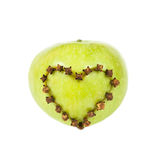 Fresh apple with a heart shaped cut out. On white background Stock Photography