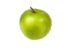 Fresh apple on an isolated background. Fresh green apple on an isolated background Stock Photo