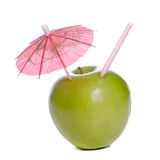 Fresh Apple Juice. Concept image of fresh apple juice featuring an apple with a straw and an umbrella in it Royalty Free Stock Photos