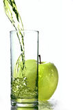Fresh apple juice in glass with green apple isolat Stock Photography