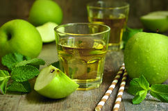 Fresh apple juice in a glass. Stock Photos