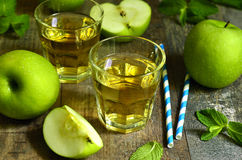 Fresh apple juice in a glass. Royalty Free Stock Image