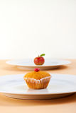 Fresh apple and little cup cake Royalty Free Stock Photo