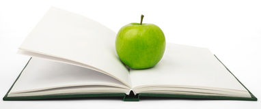 Fresh apple on notebook Stock Images