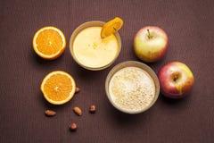 Fresh apple and orange juice stock image