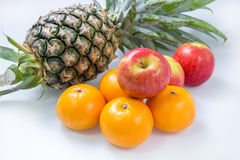 Fresh Apple Orange Pineapple on white table Royalty Free Stock Image
