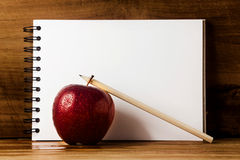 Fresh apple,paper and pencil. Stock Images