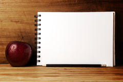 Fresh apple,paper and pencil. Stock Photo