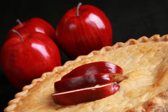 Fresh apple pie. Apple slices and whole apples adorn this freshly baked pie Stock Photography