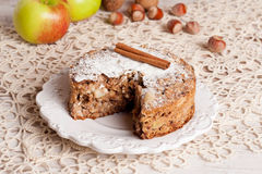 Fresh apple pie in a cut on wooden board, top view. Vertical, closeup Stock Images