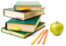 Fresh apple with pile of books Stock Images