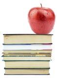 Fresh apple on pile of books Royalty Free Stock Photo