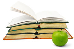 Fresh apple with pile of books Royalty Free Stock Photography