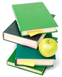 Fresh apple with pile of books Stock Photo