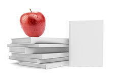 Fresh apple on pile of white books Stock Photography