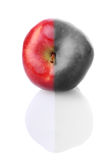 Fresh apple with red and colourless half. Fresh apple with stem and reflection, with red and colourless half Stock Photo